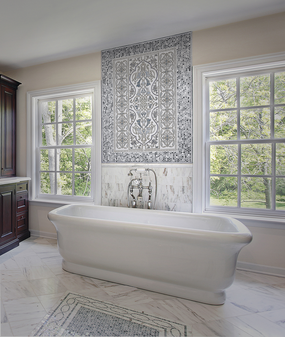 Master bath in luxury home with large white tub