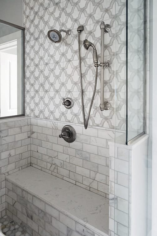 Evolve pattern on 12x12 carrara in shower wall