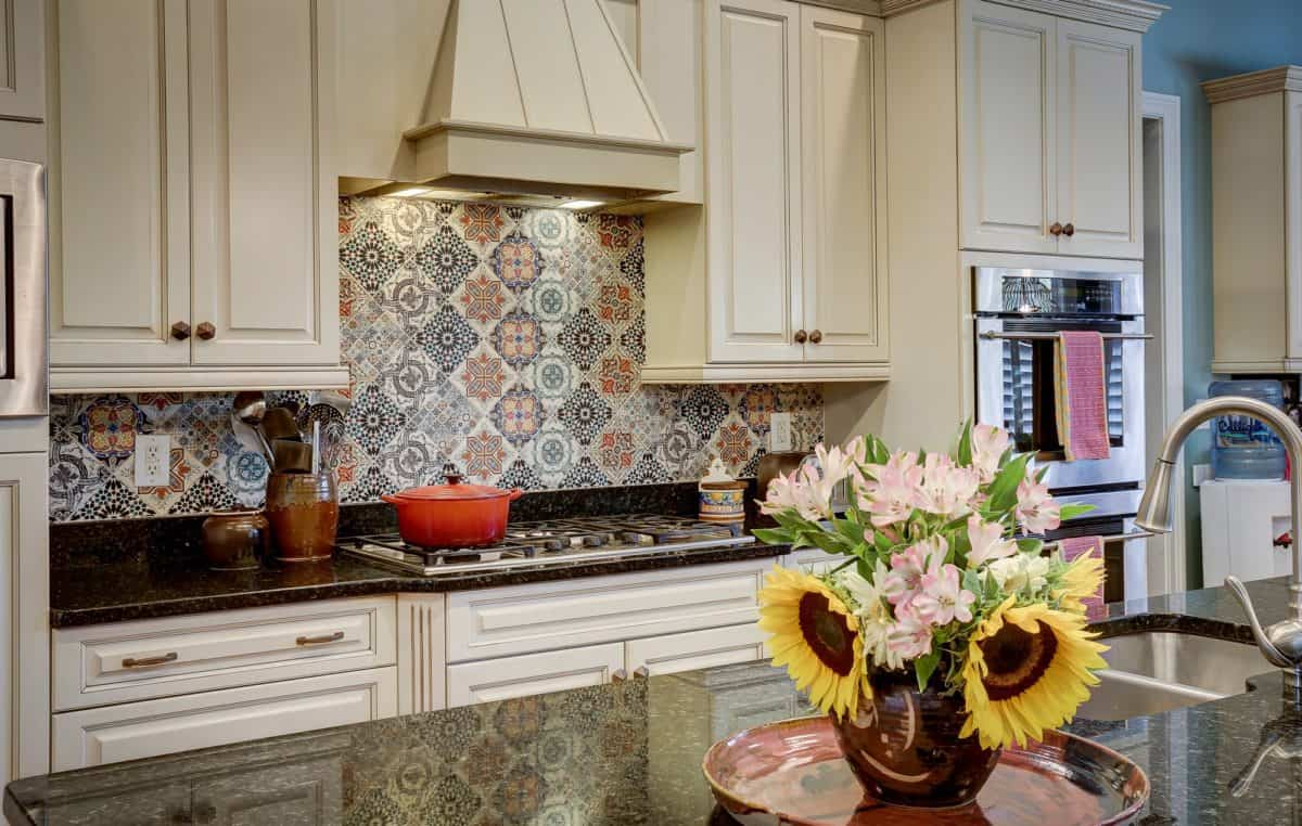 Big Sky Design created a backsplash using various patterns from the Saybrook Collection in this North Carolina Kitchen